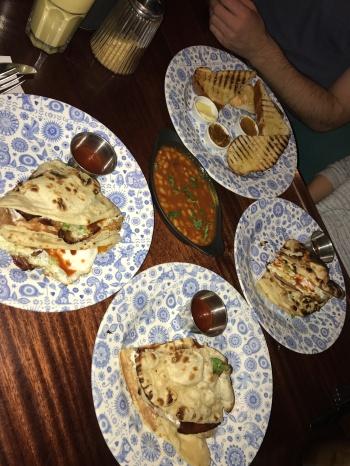 Fire toast, masala beans, bacon & egg naan rolls